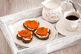 Romantic breakfast-toasts  with red caviar and coffee