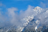 mountain peak in winter clouds