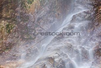 waterfall on alpine rocks