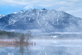 Karwendel mountains and Barmsee lake in foggy morning