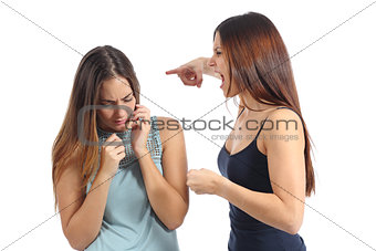 Angry woman abusing of another scared one