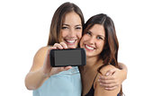 Two friends showing a blank smart phone screen