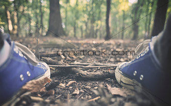 Man in sneakers in the forest