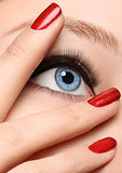 Glamour black arrow makeup close with fashion red nails