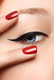 Glamour black arrow makeup close with fashion red nails on face