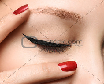 Closed glamour eye make up close with perfect shape black arrow