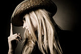 blond woman in hat