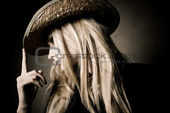 blond woman in hat