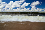 Baltic wave and cumulus clouds