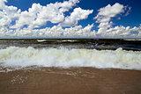 Baltic wave and cumulus clouds