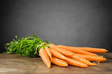 Fresh carrots on wooden table