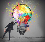 Colors a lightbulb