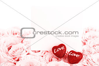 Beautiful pink roses with gift card and hearts