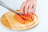 the process of cutting salmon