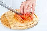 the process of cutting salmon