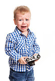 Toddler boy holding camera and crying