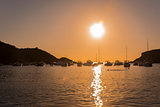 Sailboats in a harbor at sunset. Mediterranean sea of Ibiza island