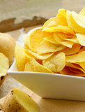 natural organic potato chips on a wooden table