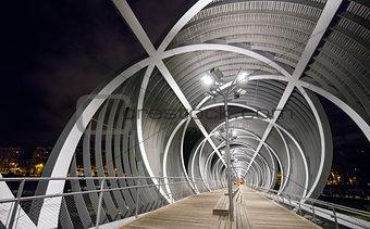 Arganzuela Bridge illuminated at night and Madrid Rio Park, Madr