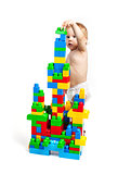 Toddler boy is playing with building blocks