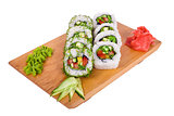 delicious sushi on a wooden board on a white background
