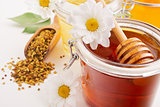 still life with honey, flowers and pollen