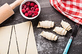 Making croissants with raspberries