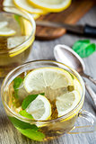 Cup with mint and lemon tea
