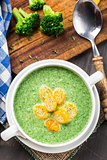 Broccoli cream soup on table