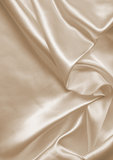Smooth elegant golden silk as wedding background. In Sepia toned