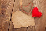 Blank old piece of paper and vintage handmaded valentines day hearts