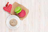 Coffee cup, colorful macarons and valentines day gift toy