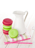 Colorful macarons and milk jug