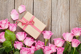 Valentines day background with pink roses over wooden table and
