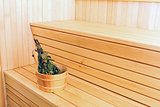 bucket with birch broom in sauna