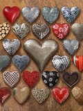 Many hearts on wood background