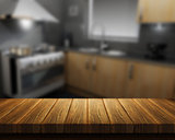 Wooden table with kitchen in background