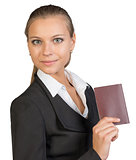 Businesswoman showing passport with blank cover