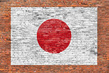 Flag of Japan painted over brick wall