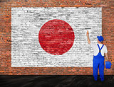 House painter paints flag of Japan