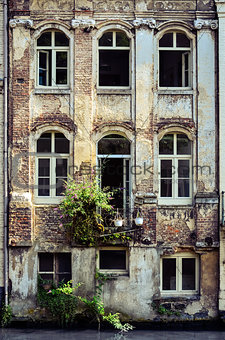Old weathered wall with vintage windows, Belgium