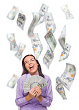 Happy Woman Holding the $100 Bills with Many Falling Around