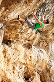Rock climber on a face of a cliff