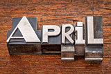 April word in metal type