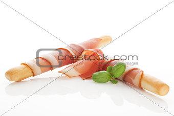 Grissini bread and prosciutto ham.