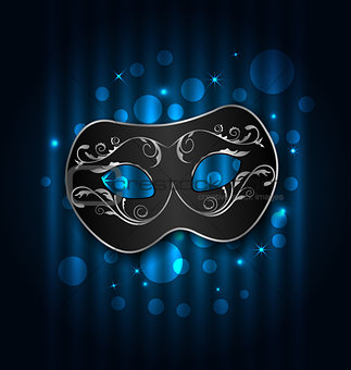 Carnival or theater mask on blue shimmering  background