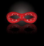 Theater red mask with reflection on black background