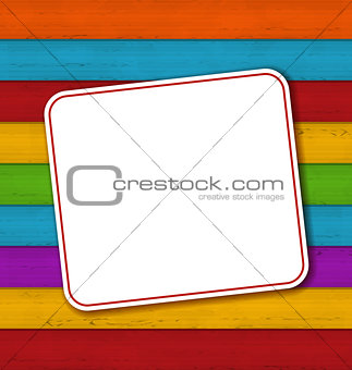 Celebration card on colorful wooden background