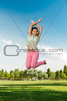 Beautiful African American woman jumping