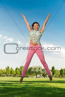 Beautiful African American woman jumping